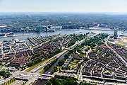 Nederland, Noord-Holland, Amsterdam-Noord, 29-06-2018; Buikslotermeer, verkeersplein/viaduct het Meeuwenei en Station Noorderpark van de Noord/Zuidlijn. Sixhaven, Noorhollandsch kanaal, Centraal Station.<br /> North Park Station w environment, new subway /underground. <br /> luchtfoto (toeslag op standard tarieven);<br /> aerial photo (additional fee required);<br /> copyright foto/photo Siebe Swart