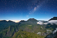 Night-time view of the Cirque de Mafate caldera on the French island of Reunion in the Indian Ocean.