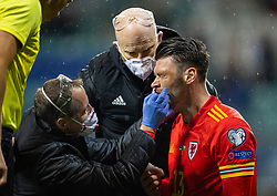 TALLINN, ESTONIA - Monday, October 11, 2021: Wales' Kieffer Moore is treated for a bloody nose during the FIFA World Cup Qatar 2022 Qualifying Group E match between Estonia and Wales at the A. Le Coq Arena. Wales won 1-0. (Pic by David Rawcliffe/Propaganda)