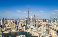 Aerial view of Dubai creek and Burj Khalifa Tower in background, U.A.E.