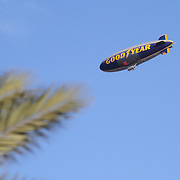 The Goodyear blimp floats above the trees at Daytona International Speedway on February 18, 2011 in Daytona Beach, Florida. (AP Photo/Alex Menendez)