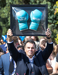 © Licensed to London News Pictures. 21/08/2018. Epsom, UK. Paddy Doherty carries boxing gloves behind the coffin at the funeral of traveller Mikey Connors in Epsom cemetery. 32 year-old Mikey Connors, the nephew of My Big Fat Gypsy Wedding star Paddy Doherty, was killed when his horse-and-cart was hit by a car in Thamesmead on July 28. Photo credit: Peter Macdiarmid/LNP