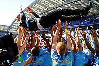 BRIGHTON, ENGLAND - MAY 12:   Manchester City manager Pep Guardiola is thrown in the air by the players as the team celebrates winning the Premeir League during the Premier League match between Brighton & Hove Albion and Manchester City at American Express Community Stadium on May 12, 2019 in Brighton, United Kingdom. (MB Media)