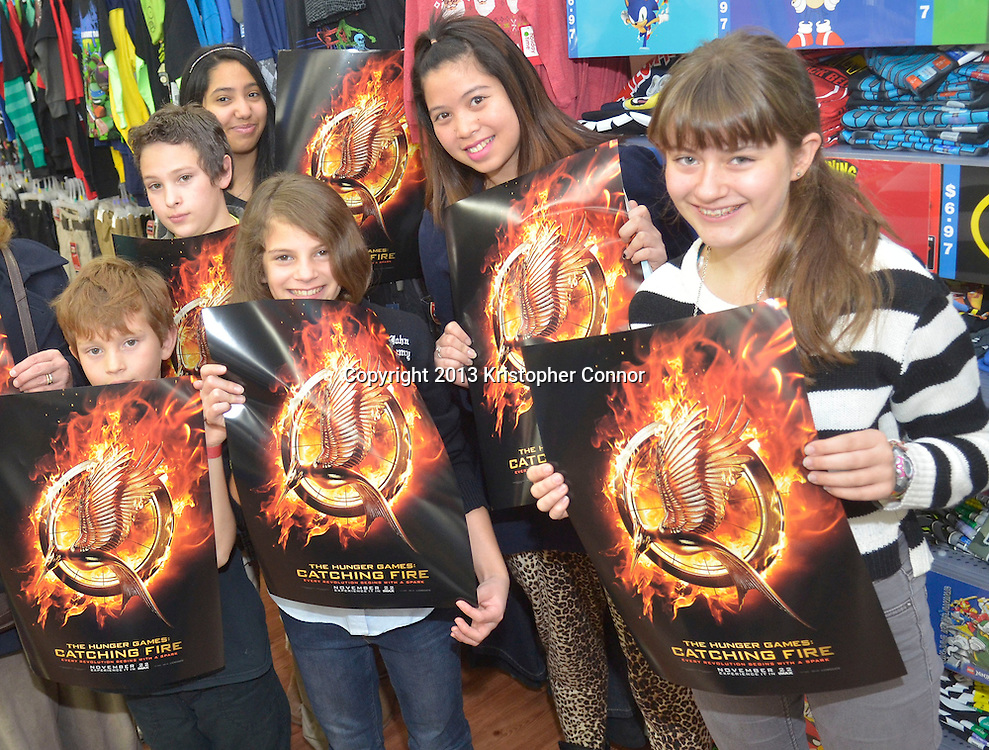 """Vienna, Va - NOVEMBER 13: Actress Willow Shields from the upcoming movie """"The Hunger Games: Catching Fire"""" signs posters and issues of Seventeen Magazine at Walmart on November 13, 2013 in Vienna, Virginia. (Photo by Kris Connor/LionGate)"""