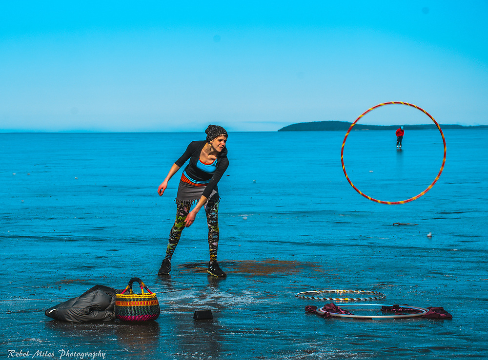 An Artist Practices Her Street Performing Skills On The Ice Of Grand Traverse Bay