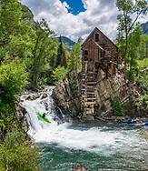 A kayaker navigating the whitewater falls at Crystal Mill near Marble, Colorado.