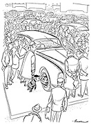 (A little boy at London Motor Show at Earls Court looks at his reflection in a shiny hubcap)
