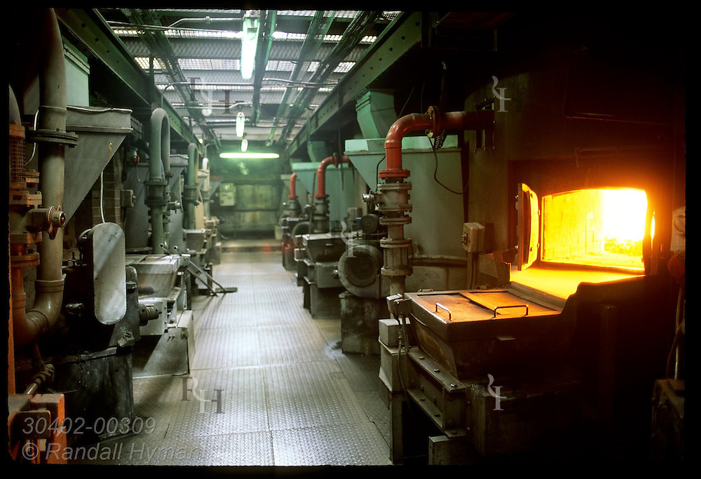 Coal-fired ovens sit in row beneath pot stills at Glenfiddich Distillry's still house;Dufftown Scotland