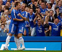 Photo: Daniel Hambury.<br />Chelsea v Manchester City. The Barclays Premiership. 20/08/2006.<br />Chelsea's John Terry (L) celebrates his goal with Arjen Robben.