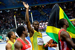 Usain Bolt of Jamaica celebrates when winning the gold medal in the mens 4x100 Metres Relay Final with mascot Berlino during day eight of the 12th IAAF World Athletics Championships at the Olympic Stadium on August 22, 2009 in Berlin, Germany. (Photo by Vid Ponikvar / Sportida)