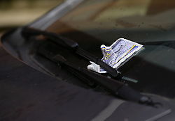File photo dated 01/09/14 of a parking ticket placed on the windscreen of a car. The number of parking tickets handed to drivers has risen by almost one million in just 12 months, according to a motoring research charity.