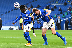 Brighton and Hove Albion's Yves Bissouma (left) heads the ball clear during the Premier League match at the American Express Community Stadium, Brighton. Picture date: Saturday May 15, 2021.