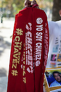 Head bands saying 'I am Chávez'' for sale during the funeral of President Chávez, Caracas, 8th March 2013. During Hugo Chávez funeral many people and stand sold miscellaneous articles that perpetuate Chávez presence. Everything from T-shirts, badges, earrings, baseball caps, sun glasses seemed suitable to have the President's image. The cult of Chávez is now more alive than ever.
