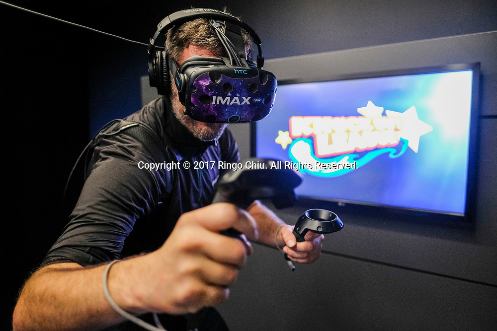A staff demonstrates the game in IMAX, a virtual reality arcade in Los Angeles(Photo by Ringo Chiu/PHOTOFORMULA.com)<br /> <br /> Usage Notes: This content is intended for editorial use only. For other uses, additional clearances may be required.