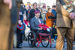 © Licensed to London News Pictures. 10/11/2019. Doncaster UK. Ben Parkinson, Britains most severely injured serviceman at Remembrance Sunday in Doncaster today. Lance Bombardier Parkinson, 34 from Doncaster, lost both legs and suffered brain damage when the armoured Land Rover he was travelling in hit a mine in Helmand Province in September 2006.Photo credit: Andrew McCaren/LNP