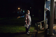 Opal Ronk says goodnight to her neighbor Mike Kubisek after the two walked home from the Lottridge Community Center in Coolville, Ohio. Kubisek moved to Lottridge two years ago but has quickly assumed a leadership role at the center, creating a Facebook group to promote the cash-strapped space.