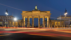 Traffic flowing in the evening in front of Brandenburg Gate in Berlin Germany