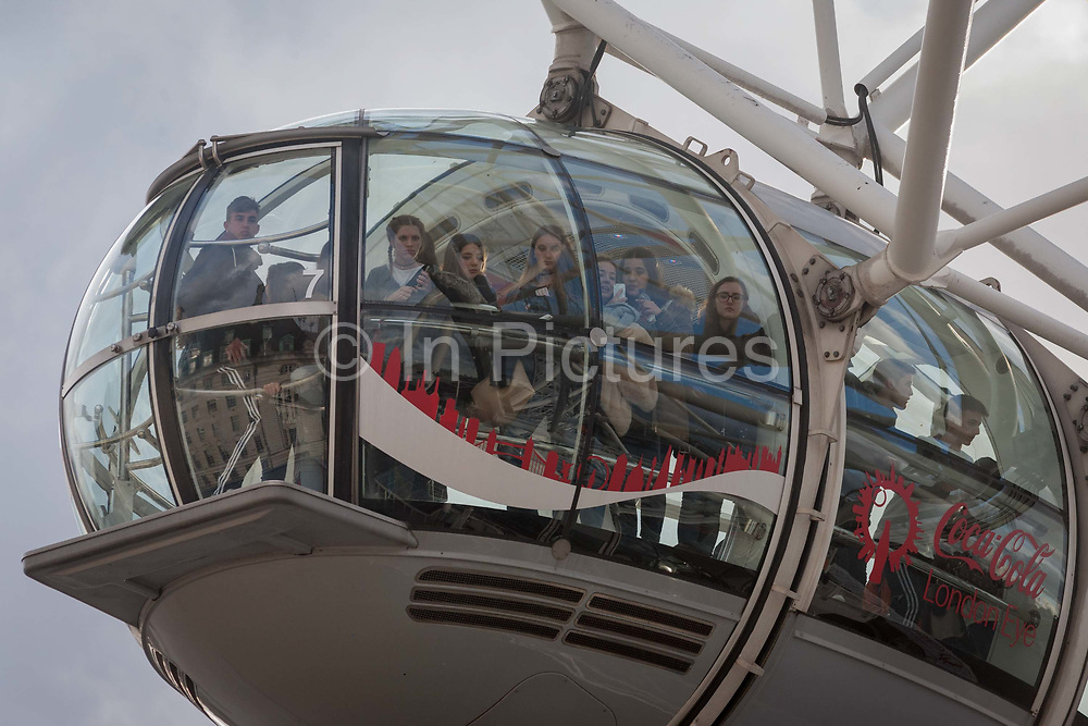 Tourists potential witnesses allowed by police to leave the London Eye hours after four people were killed including the attacker and 20 injured during a terrorist attack on Westminster Bridge and outside the Houses of Parliament, on 22nd March 2017, in central London, England. Parliament was in session and all MPs and staff and visitors were in lock-down while outside, the public and traffic were kept away from the area of Westminster Bridge and parliament Square, the scenes of the attack. It is believed a lone man crashed his car into pedestrians then, armed with a knife tried to enter Parliament, stabbing and killing a police officer at parliaments main gates.