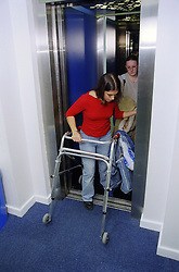 Teenage girl with physical disability using college lift,