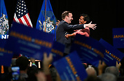 U.S. Sen. Chris Murphy embraces candidate for congress Jahana Hayes at a rally in Hartford, Conn., Friday, Oct. 26, 2018. (AP Photo/Jessica Hill)
