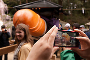 People posing for photos by the phallus shortly before the Tagata Fertility Festival began.