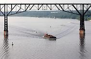 Highland, N.Y. - The tugboat Cheyenne pushes the barge Veronica Evelyn down the Hudson River near the Poughkeepsie Railroad Bridge on July 8, 2006. ©Tom Bushey