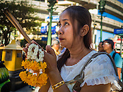 19 AUGUST 2015 - BANGKOK, THAILAND:       A Thai woman prays during the reopening of the Erawan Shrine. Erawan Shrine in Bangkok reopened Wednesday morning after more than 20 people were killed and more than 100 injured in a bombing at the shrine Monday, August 17, 2015. The shrine is a popular tourist attraction in the center of Bangkok's high end shopping district and is an important religious site for Thais. No one has claimed responsibility for the bombing.PHOTO BY JACK KURTZ