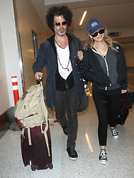 Renee Zellweger and Doyle Bramhall are seen at LAX Airport.