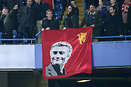 a banner is held up by fans showing Jose Mourinho, the Manchester United manager in the stands after the full time. Premier league match, Chelsea v Manchester Utd at Stamford Bridge in London on Sunday 23rd October 2016.<br /> pic by John Patrick Fletcher, Andrew Orchard sports photography.