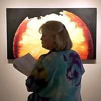 """Carole Huelbig of West Houston admires the painting called """"Ruby"""" at the Buchanan Gallery on Post Office St. during the Art Walk, 06/28/03."""