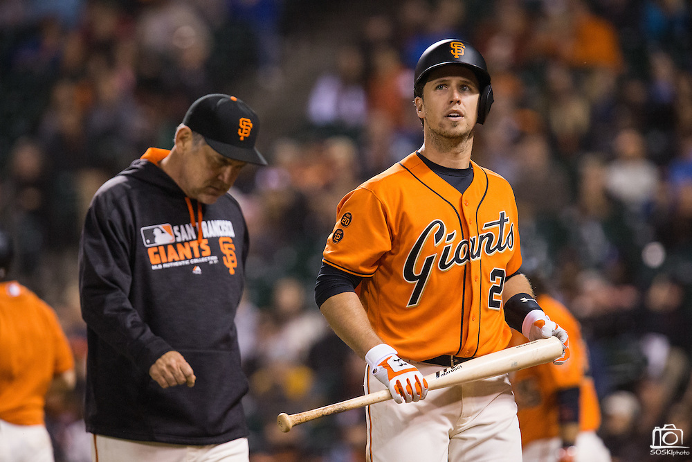 San Francisco Giants catcher Buster Posey (28) and San Francisco Giants manager Bruce Bochy (15) walk back to the dugout after striking out in the ninth inning against the Baltimore Orioles at AT&T Park in San Francisco, Calif., on August 12, 2016. (Stan Olszewski/Special to S.F. Examiner)
