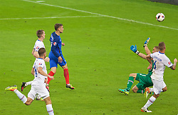PARIS, FRANCE - Sunday, July 3, 2016: France's Antoine Griezmann scores the fourth goal against Iceland, chipping the ball over goalkeeper Hannes Halldórsson, during the UEFA Euro 2016 Championship Semi-Final match at the Stade de France. (Pic by Paul Greenwood/Propaganda)