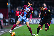 Levi Sutton of Scunthorpe United (22) turns away from Reece James of Sunderland (16) during the EFL Sky Bet League 1 match between Scunthorpe United and Sunderland at Glanford Park, Scunthorpe, England on 19 January 2019.