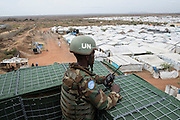 Mcc0075406 . Daily Telegraph<br /> <br /> DT Foreign<br /> <br /> <br /> <br /> An Ethiopian UN peacekeeper watches over POC 3 , the Protection of Civilian Camp inside the vast UN compound on the outskirts of Juba . Over 20,000 civilians who predominantly fled from conflict in the equatorial states of South Sudan . United Nation's agencies recently announced a famine in the war torn country .<br /> <br /> Juba 27 February 2017