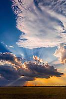 Sunset behind clouds, Nxai Pan National Park, Botswana.