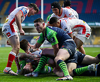St Helens' Mark Percival scores his side's second try despite the efforts of Huddersfield Giants' Chris McQueen and Matty English<br /> <br /> Photographer Alex Dodd/CameraSport<br /> <br /> Rugby League - Betfred Challenge Cup Quarter Finals - St Helens v Huddersfield Giants - Friday 7th May 2021 - Emerald Headingley Stadium - Leeds<br /> <br /> World Copyright © 2021 CameraSport. All rights reserved. 43 Linden Ave. Countesthorpe. Leicester. England. LE8 5PG - Tel: +44 (0 116 277 4147 - admin@camerasport.com - www.camerasport.com