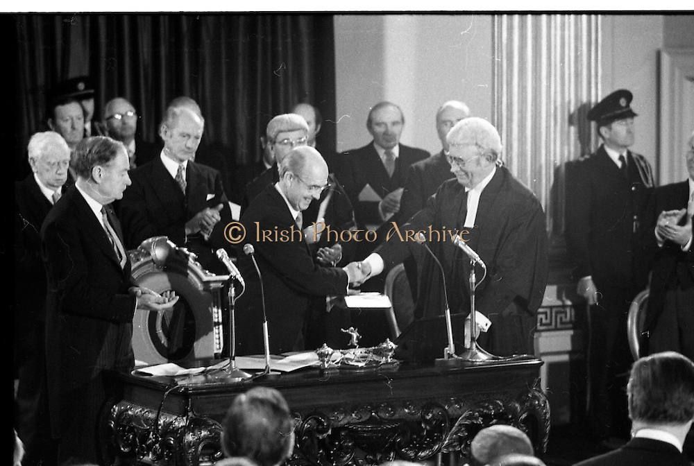Inaugeration of Cearbhall O'Dalaigh as President  (H77).1974..19.12.1974..12.19.1974..19th December 1974..Following the sudden death of President Erskine Childers, Mr Cearbhall O'Dalaigh was nominated by The Fianna Fail party as its candidate to replace him. The Fine Gael /Labour coalition government did not oppose the nomination and Mr O'Dalaigh was elected un-opposed on a joint party agreement...Image of Chief Justice O'Higgins as he is first to congratulate President O'Dalaigh on his appointment.