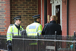 © Licensed to London News Pictures. 23/05/2013. Greenwich, United Kingdom. Metropolitan Police officers search a flat off Eastney Street in Greenwich in connection with the murder of a soldier in Woolwich  Photo credit : Rob Powell/LNP