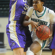 UNCW's Amber Reeves drives on Western Carolina's Ace Easter Saturday November 29, 2014 at Trask Coliseum in Wilmington, N.C. (Jason A. Frizzelle)