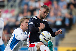 Queen of the South's Kevin Dzierzawski and Falkirk's Rory Loy.<br /> Falkirk 1 v 1 Queen of the South, Scottish Championship game played today at The Falkirk Stadium.