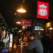 Supporters of Liverpool Football Club watch at match against Aston Villa at Varnish in Wilmington, N.C. November 2, 2019. (Jason A. Frizzelle/Cape Fear Photos)
