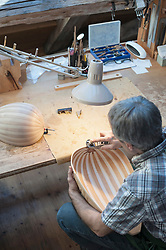 Craftsman manufacturing lute at workshop