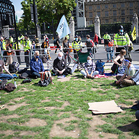 Members of clergy, including the Right Rev. Dr Rowan Williams, former Archibishop of Canterbury, sit in prayer an meditation outside Parliament in London during a demonstration of Extinction Rebellion urging government to take action on climate change.