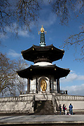 Buddhist Peace Pagoda in Battersea Park on 1st February 2020 in London, England, United Kingdom. At a time when the fear of nuclear attack appeared to be escalating the offer of a Peace Pagoda to promote world peace and harmony the pagoda was offered to the people of London by the Nipponzan Myohoji Buddhist Order as part of the 1984 Greater London Council GLC Peace Year.