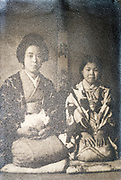 deteriorating mother with cat and daughter casual indoors portrait Japan ca 1930s