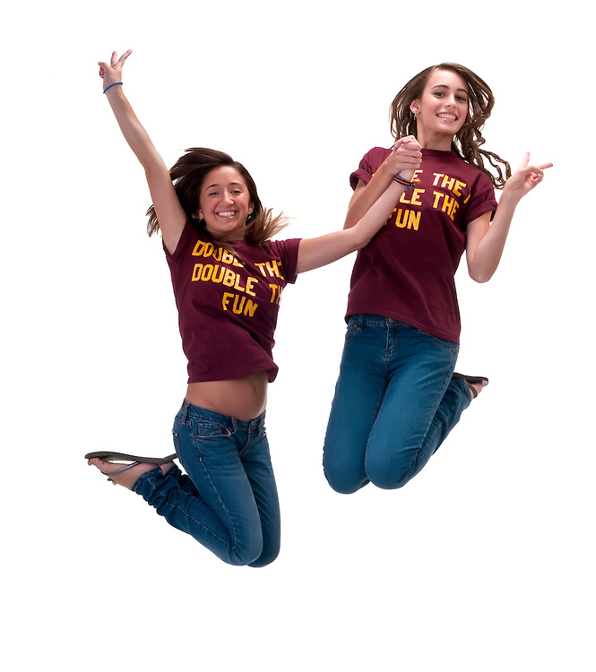 Young friends jumping together very happy and high.