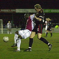 Picture: Raymond Field<br /><br /><br />Woking F.C v Kidderminster Harriers FA second round<br /><br />06/12/2003<br /><br /><br />Davis Haule gets to the ball before Steve Burton