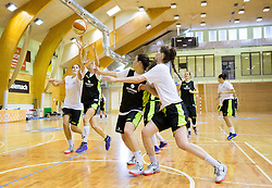 Katja Kotnik and Helena Boada (L) during practice session of Slovenian Women Basketball Team, on May 14, 2014 in Arena Vitranc, Kranjska Gora, Slovenia. Photo by Vid Ponikvar / Sportida