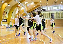Katja Kotnik and Helena Boada (L) during practice session of Slovenian Women Basketball Team, on May 14, 2014 in Arena Vitranc, Kranjska Gora, Slovenia. Photo by Vid Ponikvar / Sportida