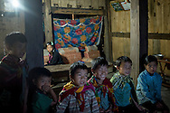 Hmong kids gather to watch TV in a house in Lao Chai, Lao Cai Province, Vietnam, Southeast Asia